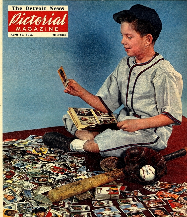 a-kid-from-1955-looks-through-his-baseball-card-collection